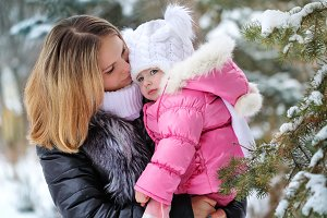 Mother and daughter hug. Winter fun