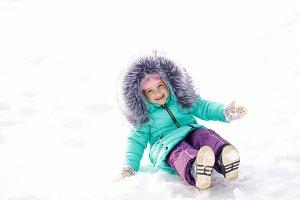 Little girl sitting in snow