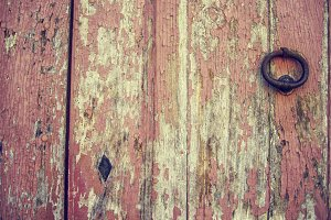 Close up of old painted pink door