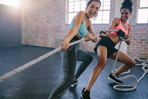Two women doing intense workout