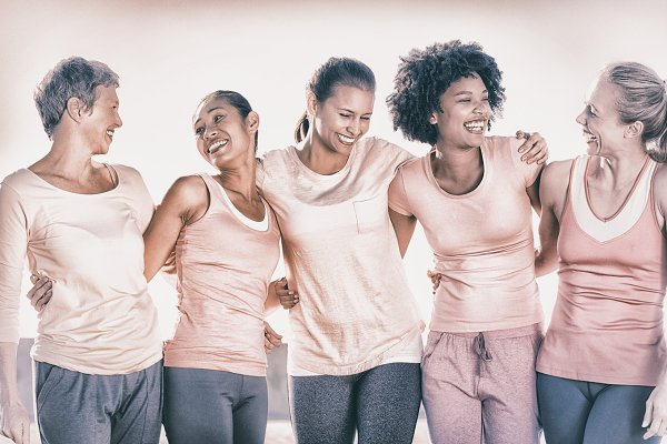 Laughing women wearing pink for bre…