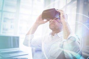 Businessman holding virtual glasses