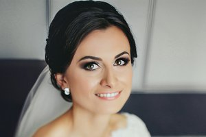 Brunette bride smiles