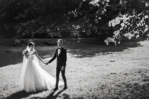 Wedding couple walking in the garden