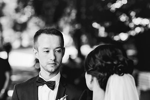Groom looks at a bride