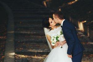 Stylish wedding couple in the park