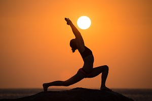 Yoga by woman silhouette