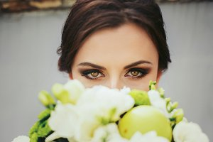 Brunette bride with magic green eyes