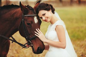 Bride leads to a brown horse