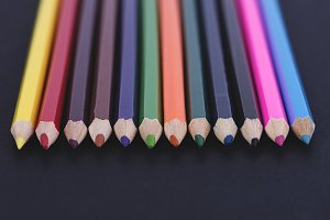 Close-up of colored pencils on black background