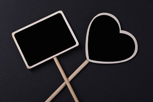 Two small blackboard with square shape and heart on black background