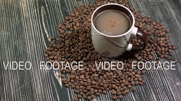Cup Of Coffee And Grains On Table On Dark Background Fragrant Hot Drink