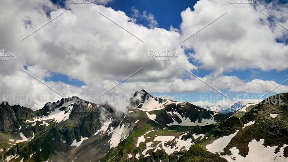 High Snowy Tops of Mountains with Clouds Timelapse. Kavkaz region in Graphics