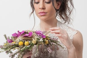 Bride holding bouquet with orchids