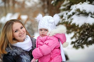 Mother and daughter embrace. Winter