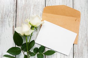 White roses with envelope