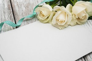 White roses with greeting card