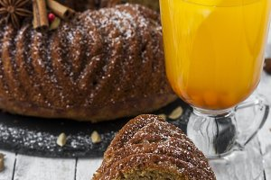 homemade cake with pumpkin on wooden background