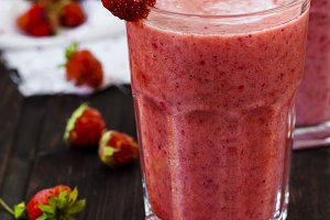 two glass of cold strawberry milk shake