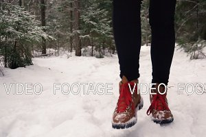 winter boots on snowy road in the forest