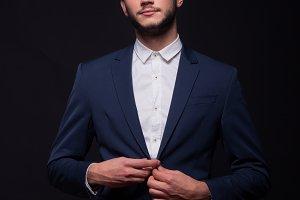 man buttoning jacket suit elegant
