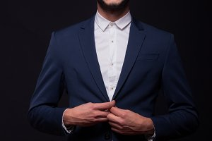 man buttoning jacket suit elegant