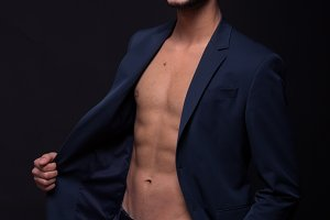 man shirtless abs chest jacket suit