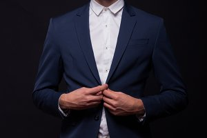 man happy buttoning jacket suit