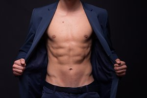 model man shirtless abs fit suit
