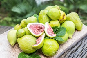 Ripe fig fruits on the wood