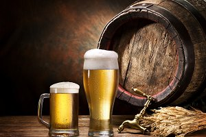 wooden pin of beer, glass of beer