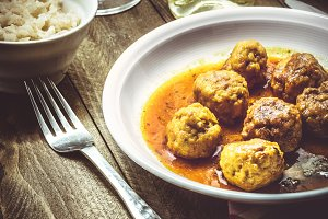 Meatballs with white rice.