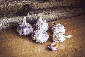 Garlic on vintage wooden background