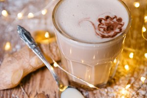 Creamy ginger coffee on the wooden table Christmas