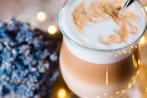 Fancy latte coffee in glass jar