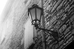 Street lamp on the wall. San Marino.