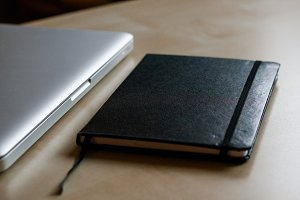 Travel Diary and Laptop