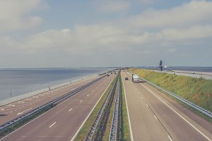 Highway on dyke in the Netherlands