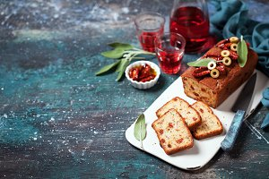 Savoury loaf cake with cheese, tomatoes, ham and olives