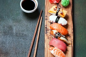 Nigiri sushi set on wooden serving board