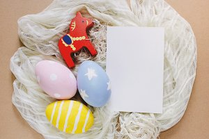 Easter eggs with blank greeting card