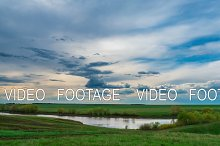 time lapse landscape clouds over lake beautiful view of the water recreation spring summer tide Nature wakes up pure white cloud moving fast in the sky wind beautiful picture background lake trees green grass