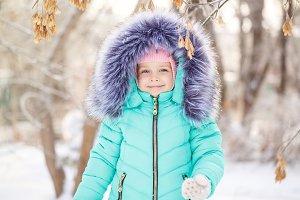 Little girl smiling in winter.