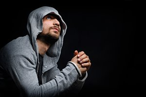 Man in the hood. Prayer.