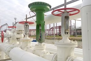 Green pneumatic valve on the pipeline