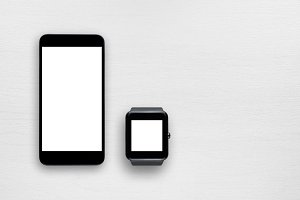Smartphone and smartwatch on table