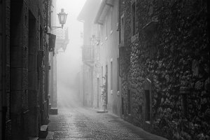 Old narrow street of San Marino during foggy weather