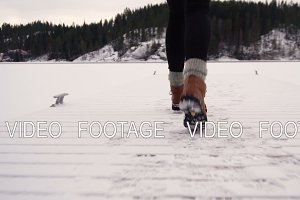 happy young woman on frozen lake
