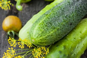 Harvest cucumbers on the wooden background