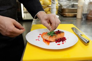 Chef is decorating fried salmon